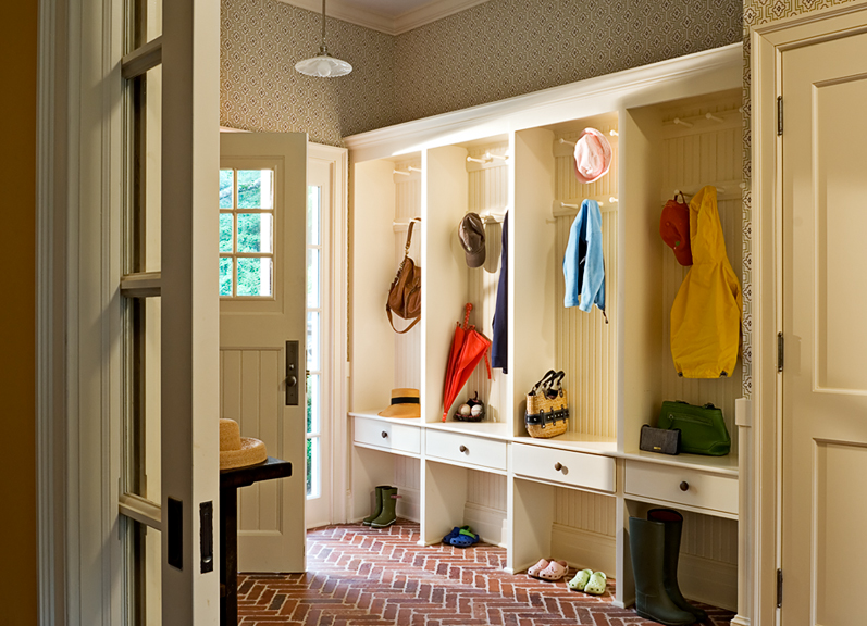 Mud Room -  A set of built-in organizers in a mud room can transform a small space. Places for coats and shoes can be a strong design element, combined with interesting wallpaper and a dynamic floor this room feels just the right size.