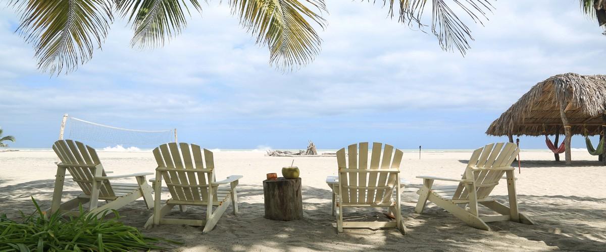 white-chairs-beach-for-website-1200x500@2x.jpg