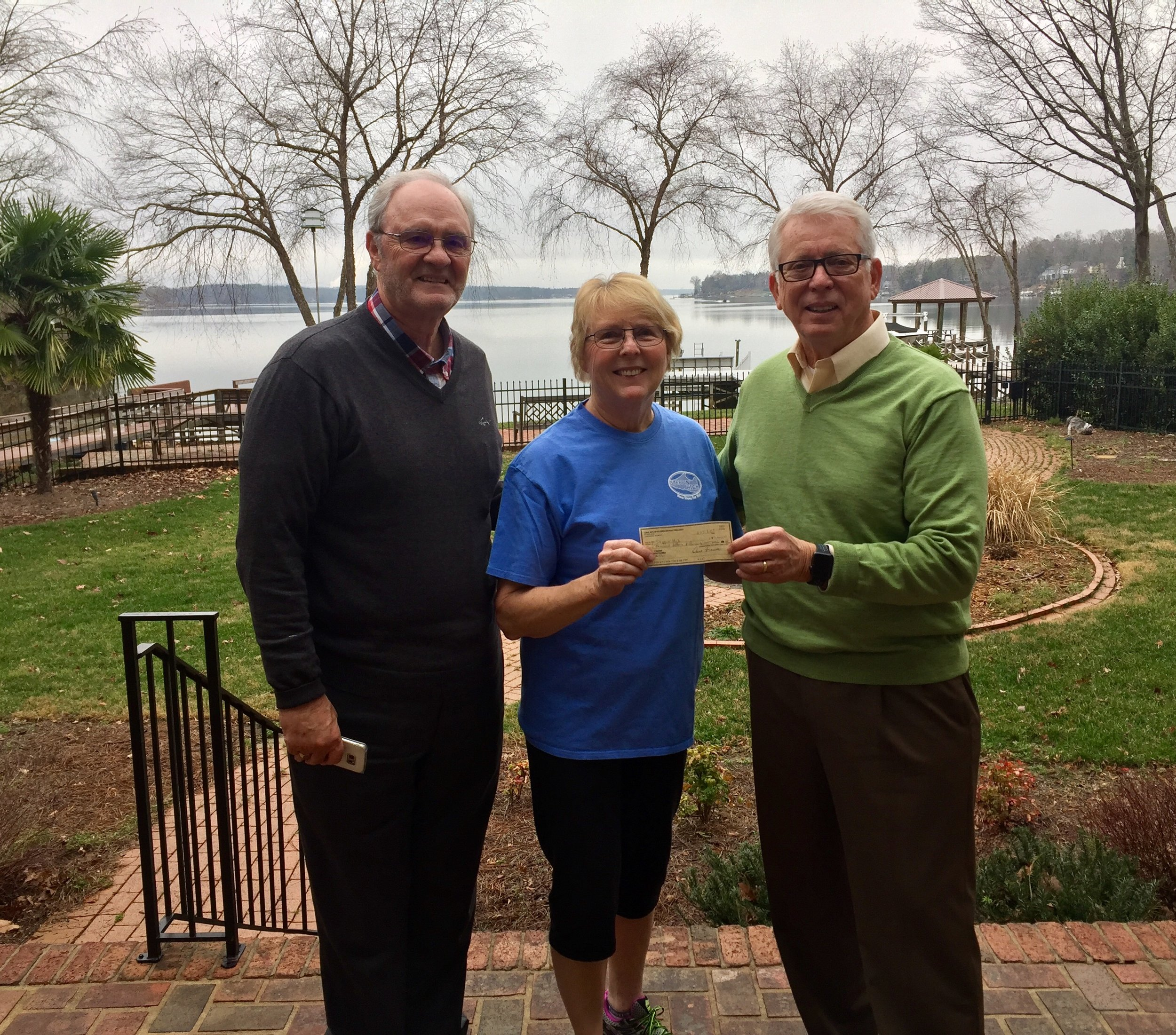 Golf Tournament Chairman, Bob Powers and President Dave Brown present a check to Steppin' High Executive Director, Linda Godbold. Steppin' High provides new shoes to homeless and needy children in York County. Over 400 pair of shoes are distributed to children in the Clover Schools annually.