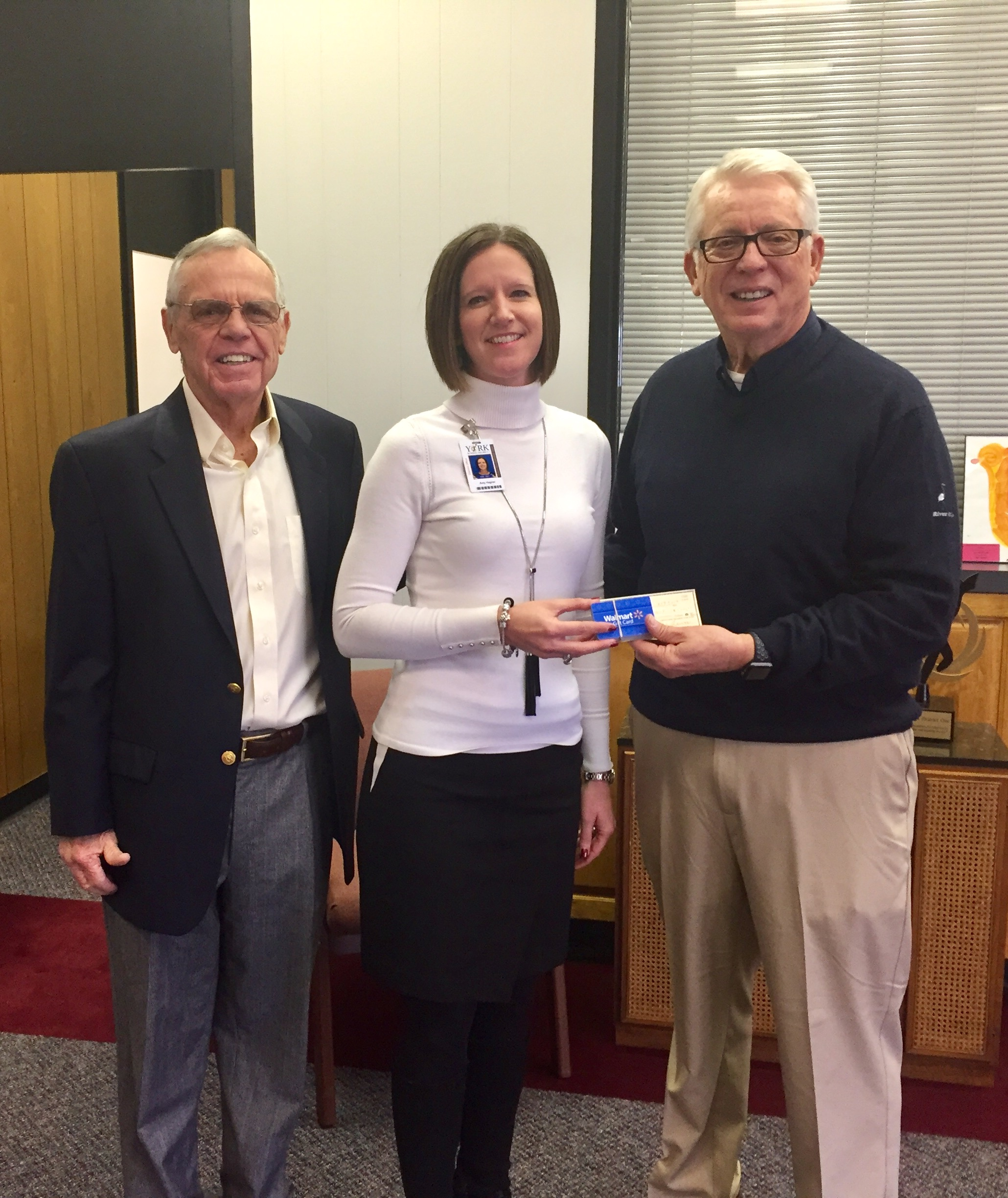 Board Member Jay Moore and President Dave Brown present a check and gift cards to Amy Hagner, Director of Finance for the York School District to aid in their efforts to provide assistance to homeless and children in need throughout the school district.