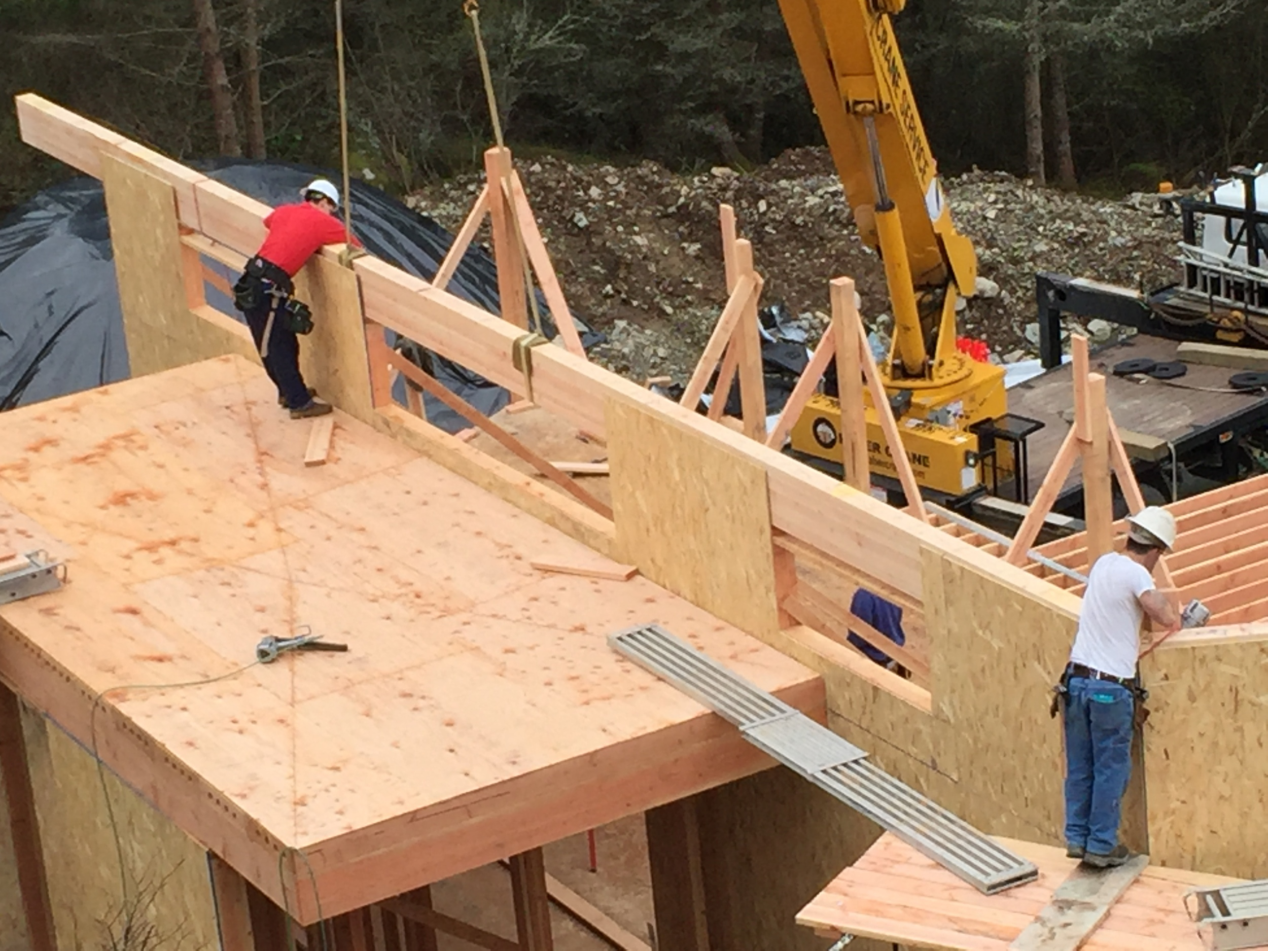 Beams are set on top of the walls, sheathing keeps the beams in place.