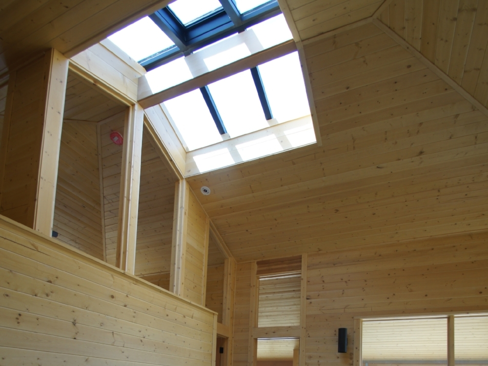 A central skylight helps illuminate the whole interior.  A motorized operator within the skylight exhosts built up heat.