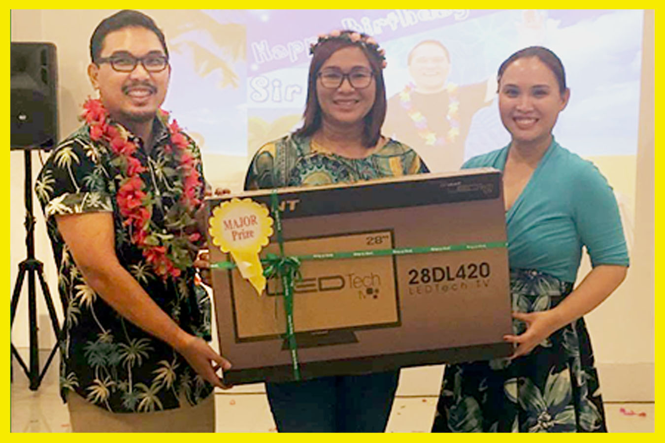 """Area Manager North Branches Rowena Rosales won the 28"""" LED TV as a Grand Prize"""