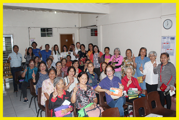 Rang-ay Bank officers pose for a group photo with Senior Citizens of Baguio City.