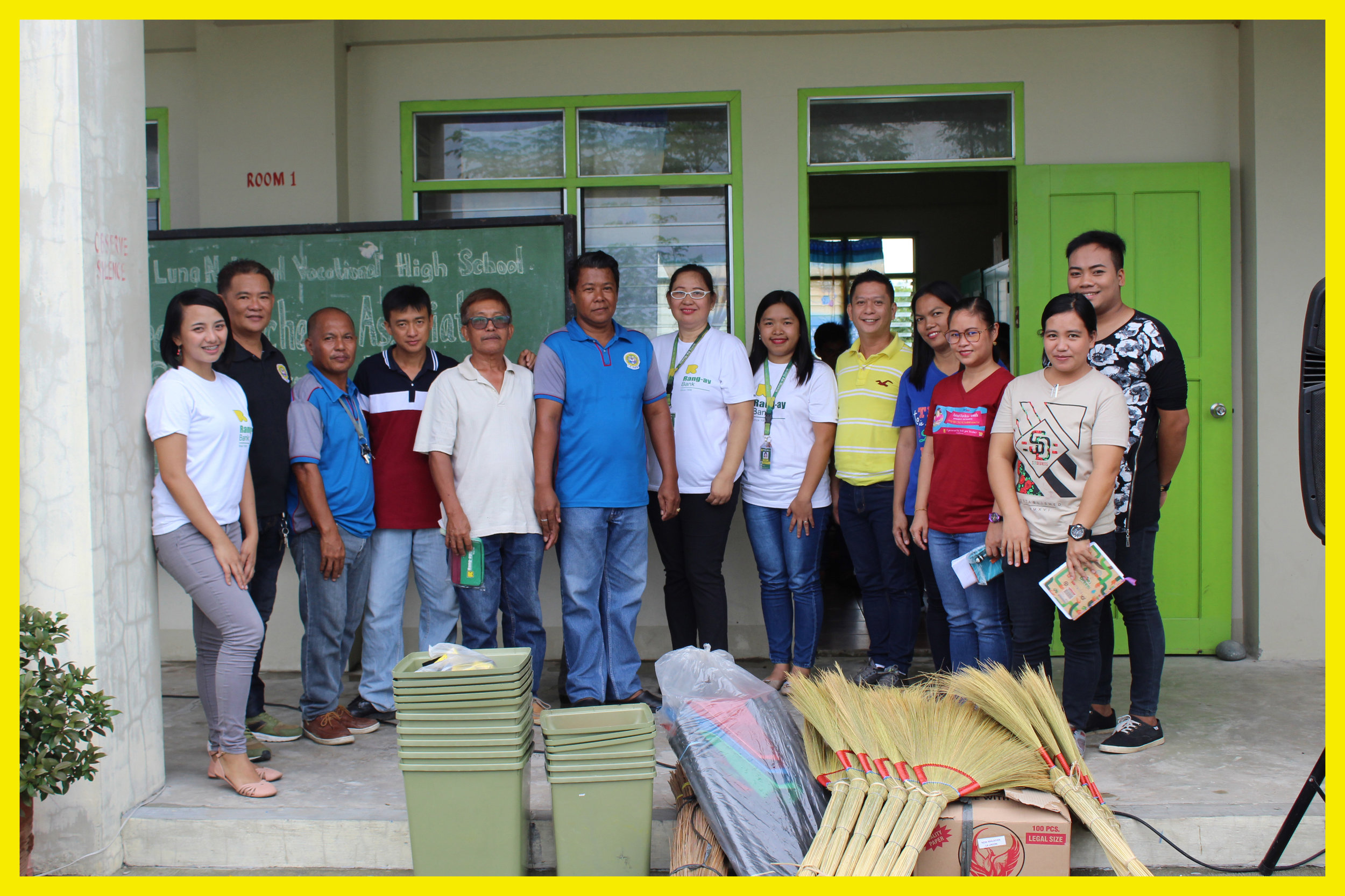 Rang-ay Bank officers turned over the cleaning materials and teaching tools to the teachers of Luna National Vocational High School