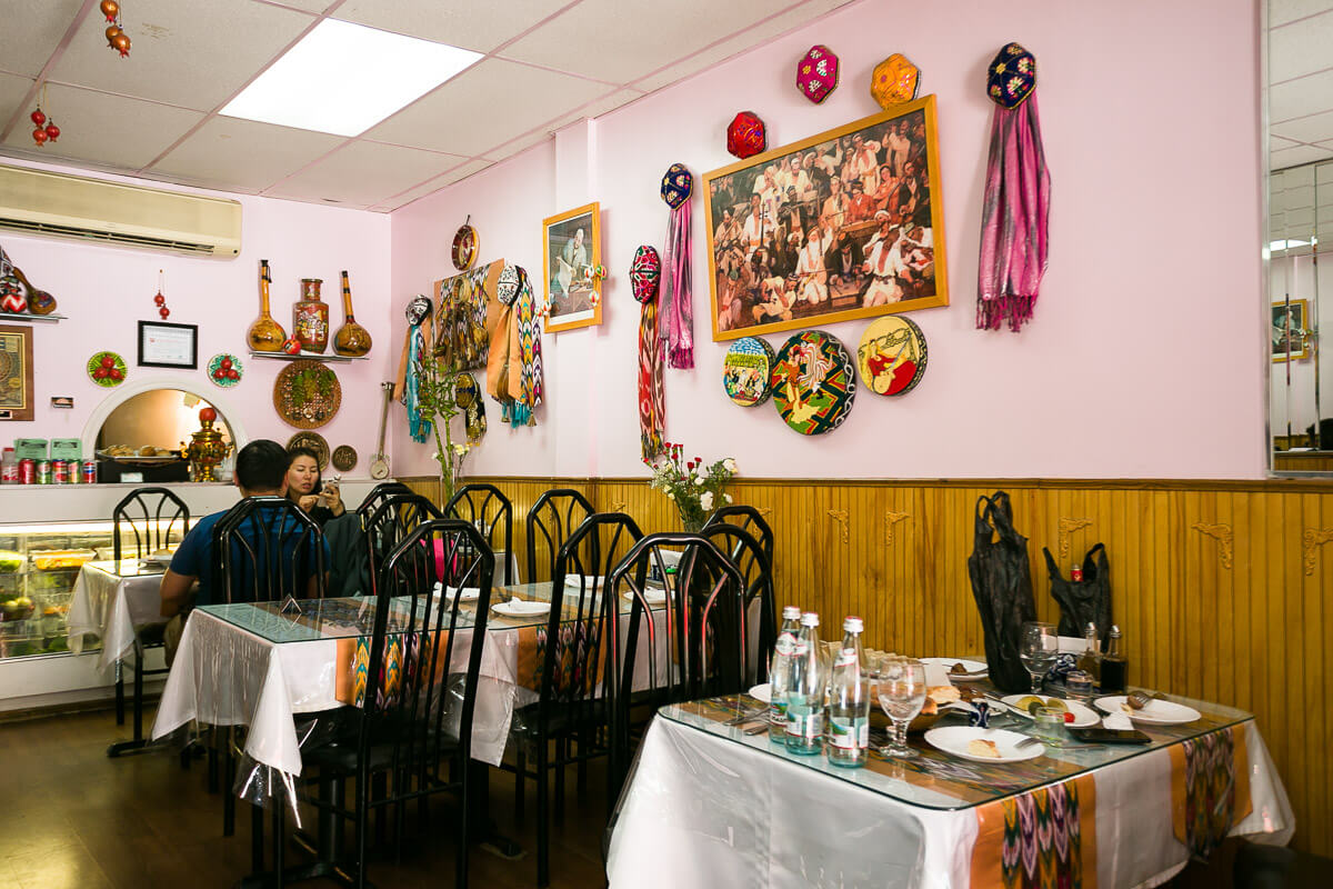 Inside the walls are prominently decorated with traditional Doppa hats, scarves, paintings, and items iconic to Uyghur heritage.