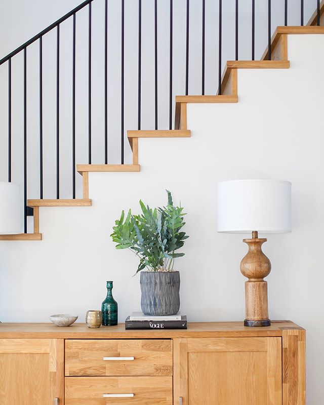 Welcoming entry moment from our Port Streets project... Photo: @ryangarvin  #welcome #entry #entryway #entrywaydecor #stairs #stairdesign #whiteoak #architecture #design #interiordesign #designbuild #claytonbuilders #customhome #modernfarmhouse #portstreets #newportbeach #weekend