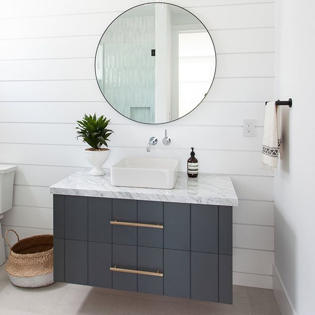 Happy Friday...guest bath goodness from our project Newport Heights 🙌✨ #shiplap #finishcarpentry #vgroove #customvanity #roundmirror #bathroomdesign #interiordesign #designbuild #claytonbuilders #customhome #newportheights 📸: Luke Lighthouse