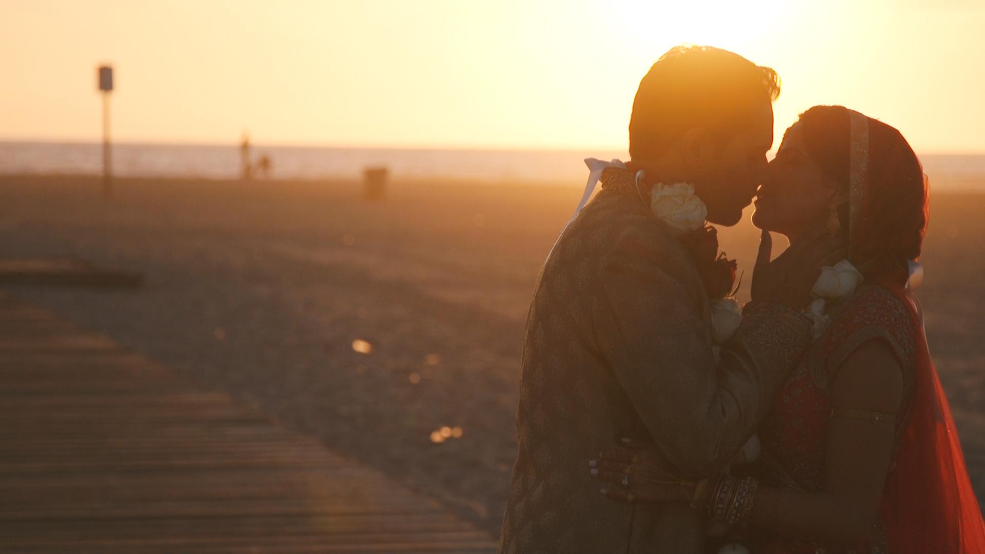 beach-wedding-kiss-indian-wedding.jpg