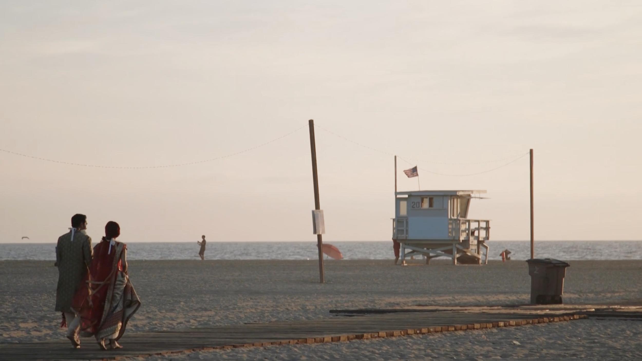 indian-wedding-couple-boardwalk-beach.png