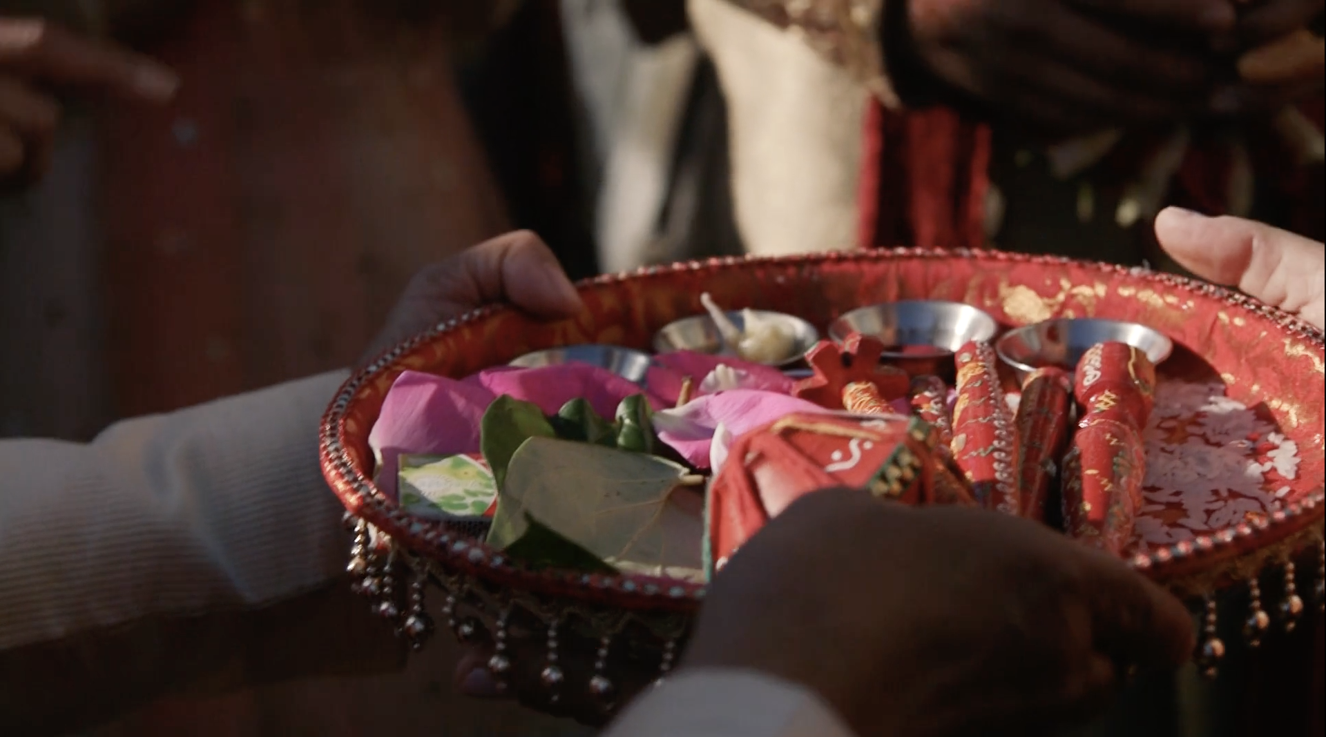indian-wedding-red-tray-with-flower-petals.png