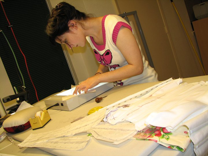 Marianne Faulkner (Pop Antique) pattern drafting with a lightbox under the tutelage of Alexis Black (Electra Designs) circa 2010. For efficiency, I now just use the slight transparency of pattern paper itself.