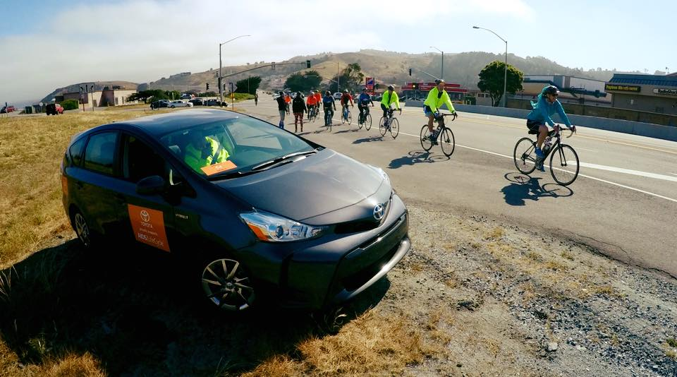 Safety Prius on side of road with cyclists.jpg