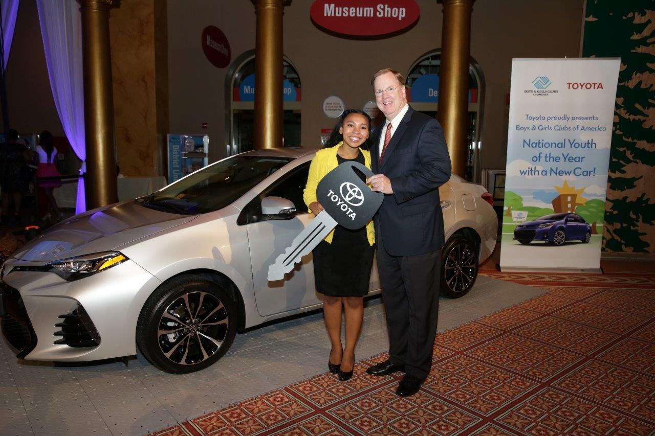 Jocelyn Wood stands with Toyota Financial Services President & CEO Mike Groff in front of her new 2016 Corolla. She was awarded the Corolla for overcoming the struggles of her community, determined to succeed as she starts her studies in journalism at the University of Southern California.
