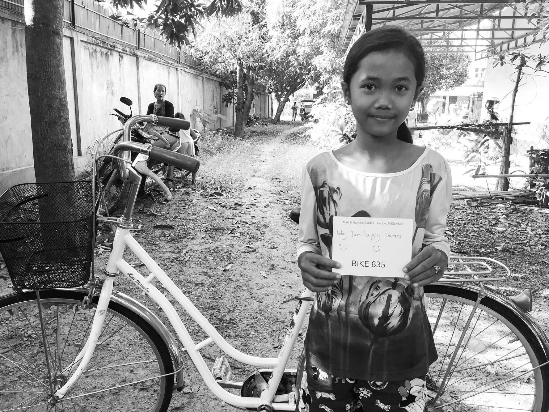 Girls receiving their bikes from Opulen 88Bikes
