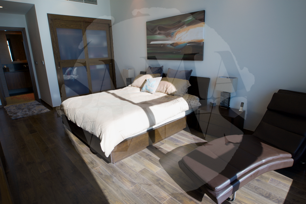 A spacious master bedroom with king-sized bed will ensure you rest well after a hard day at the pool