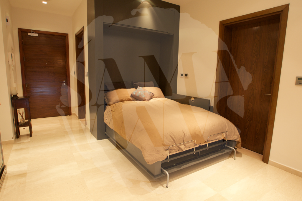 The apartment offers a second double bed that folds out from the wall and tucks back up easily during the day
