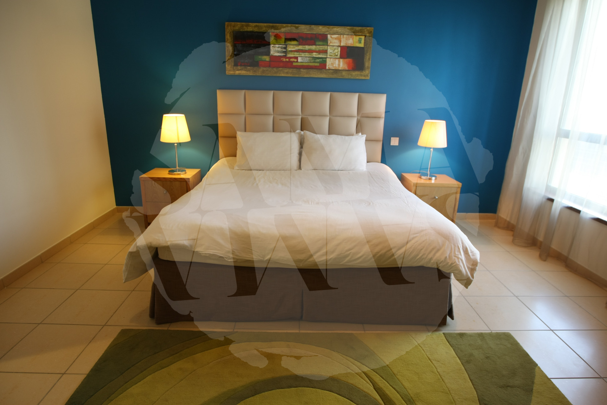 The spacious bedroom is the perfect setting to finish off a long day
