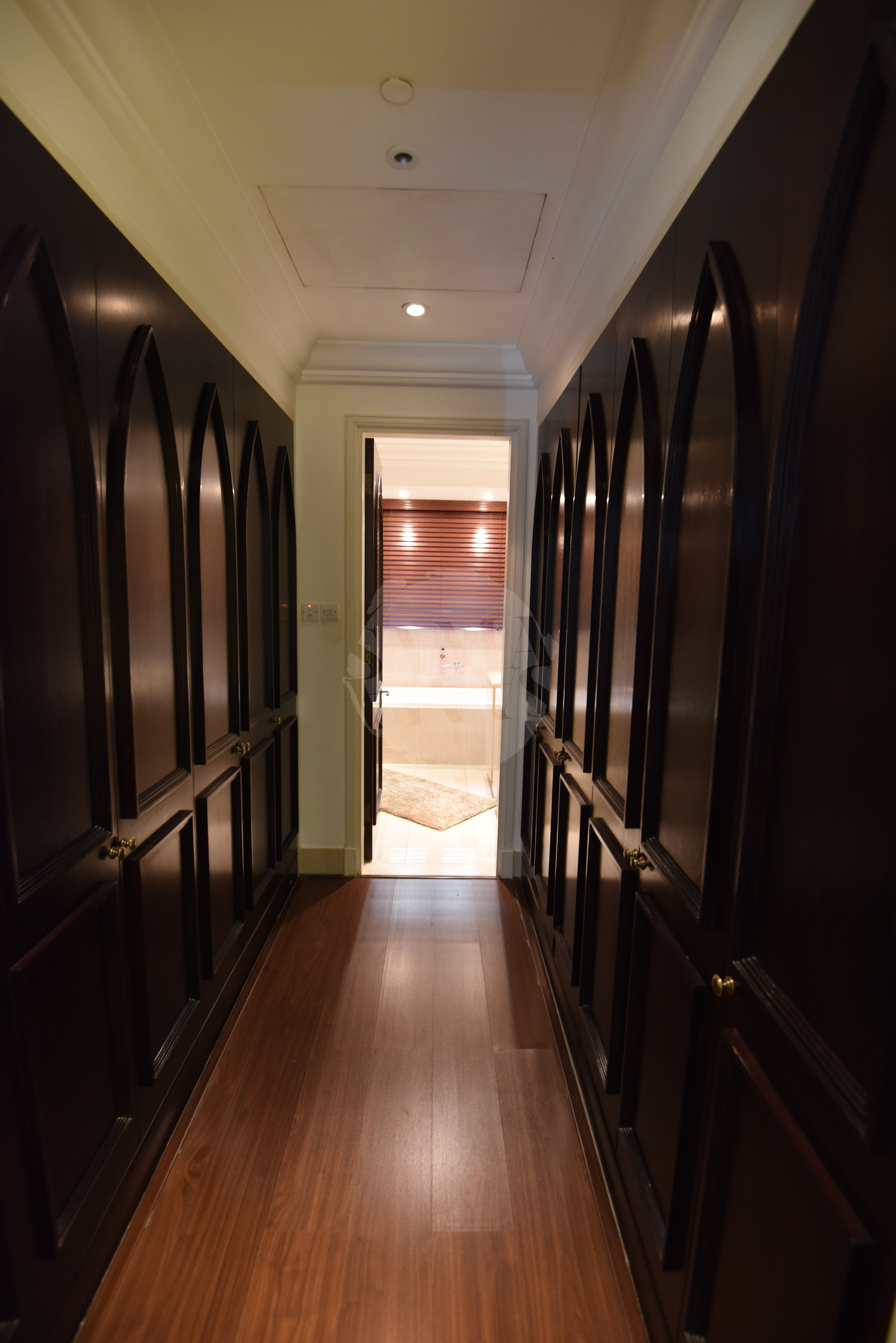 The bedroom leads onto a huge walk-in closet with ample storage space for all your things