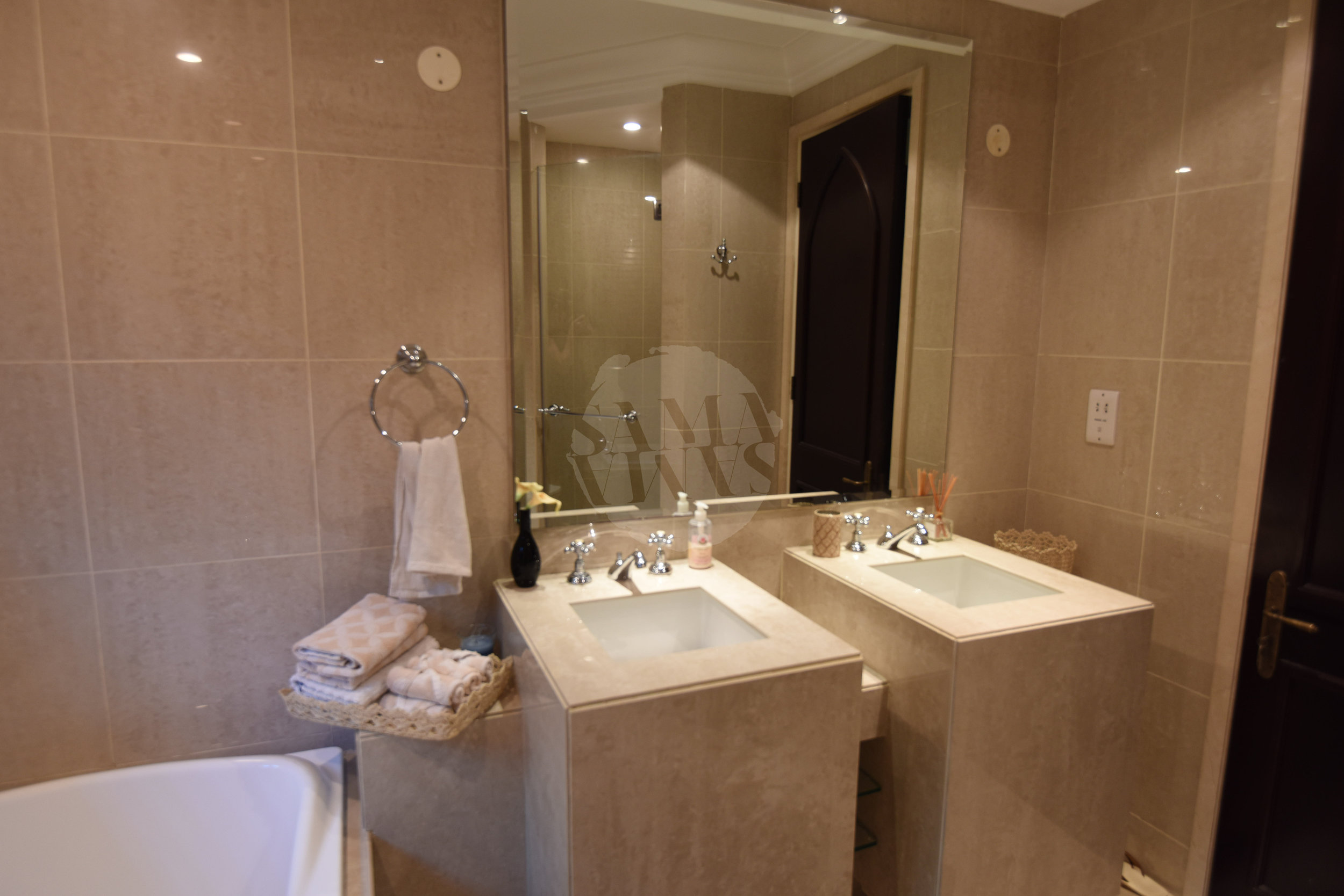 The ensuite is complete with His and Hers sinks, luxurious bath & seperate rain-shower