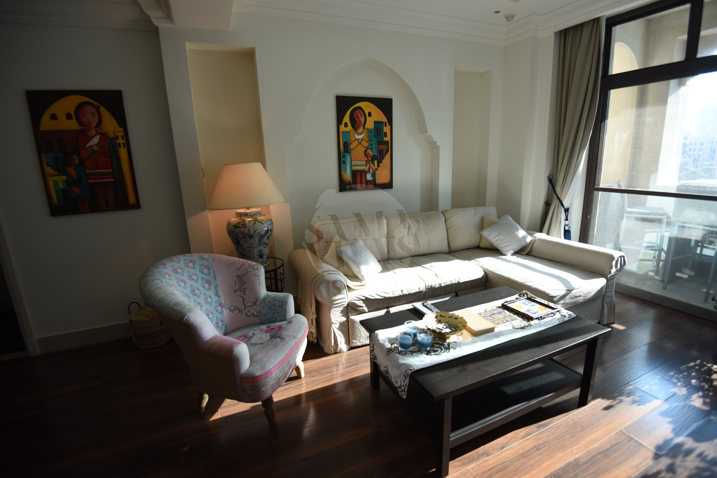 The living area is the perfect place to relax as it welcomes the sunset light through the balcony as the day winds down