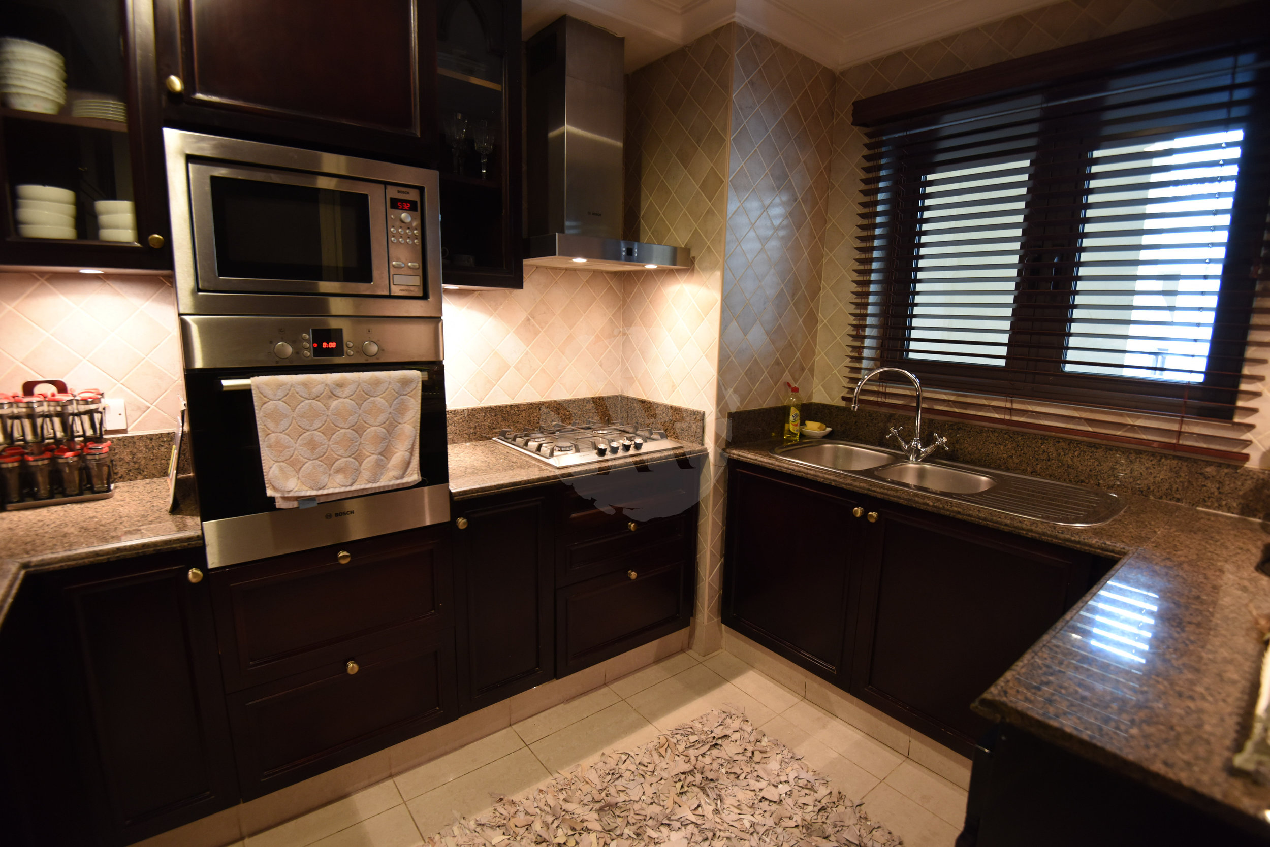 The fully furnished kitchen offers all the amenities you require during your stay