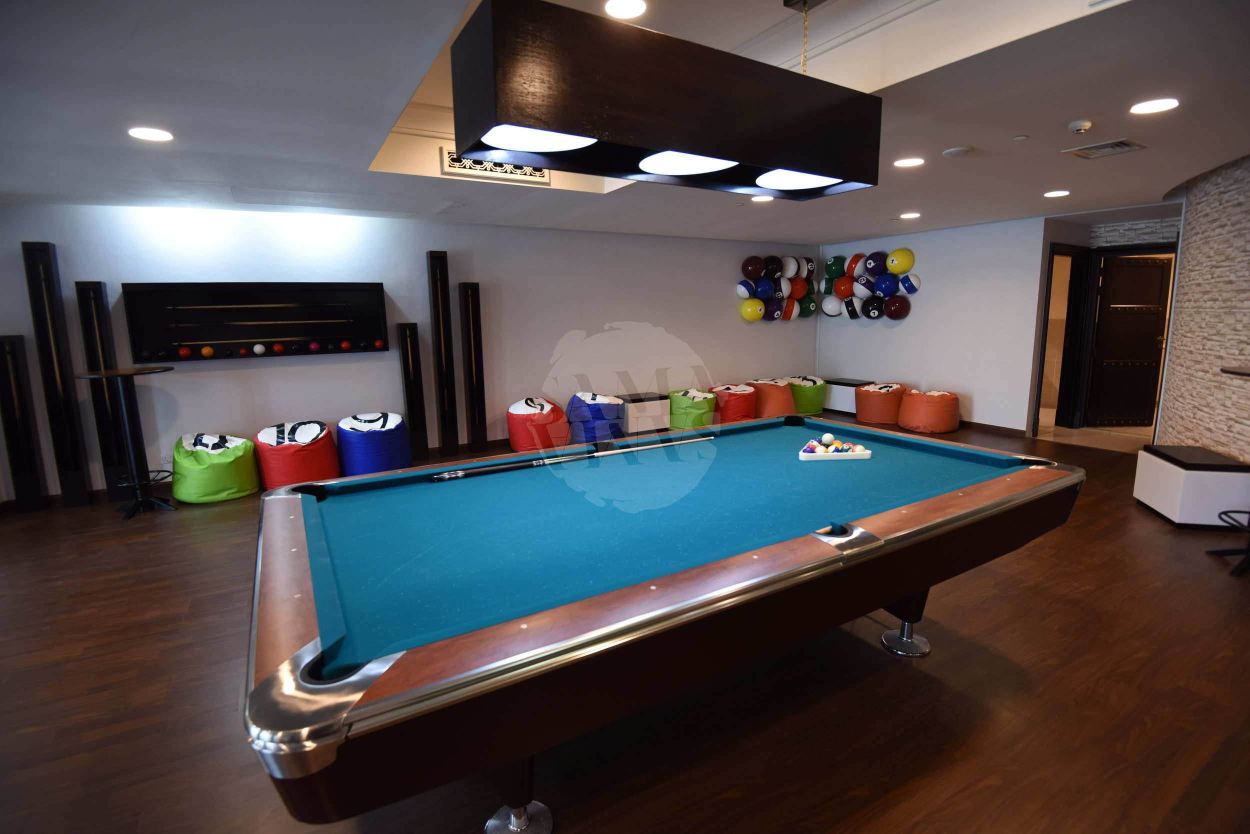 The billiards room is spacious and the perfect place to spend an afternoon