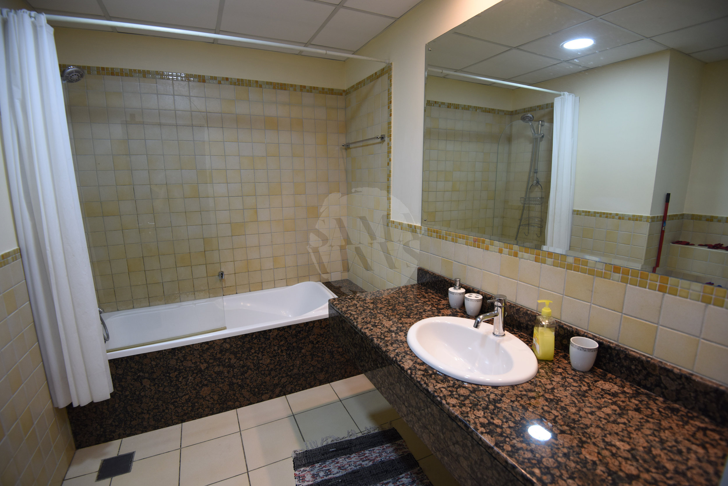 There are two large bathrooms with baths and showers, and a guest WC