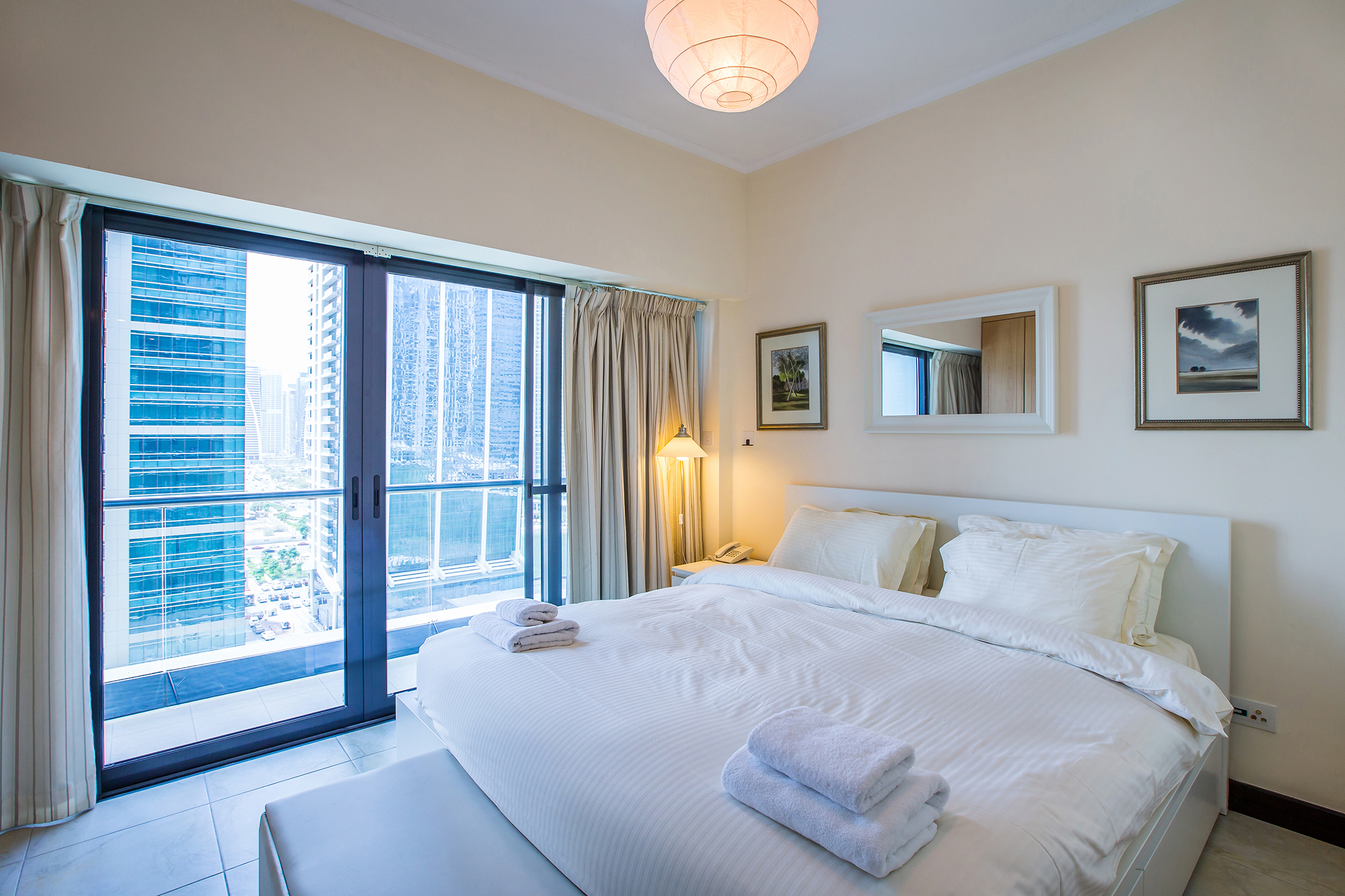 Extremely comfortable king size bed, partitioned from the rest of the studio for privacy with a majestic lake view.