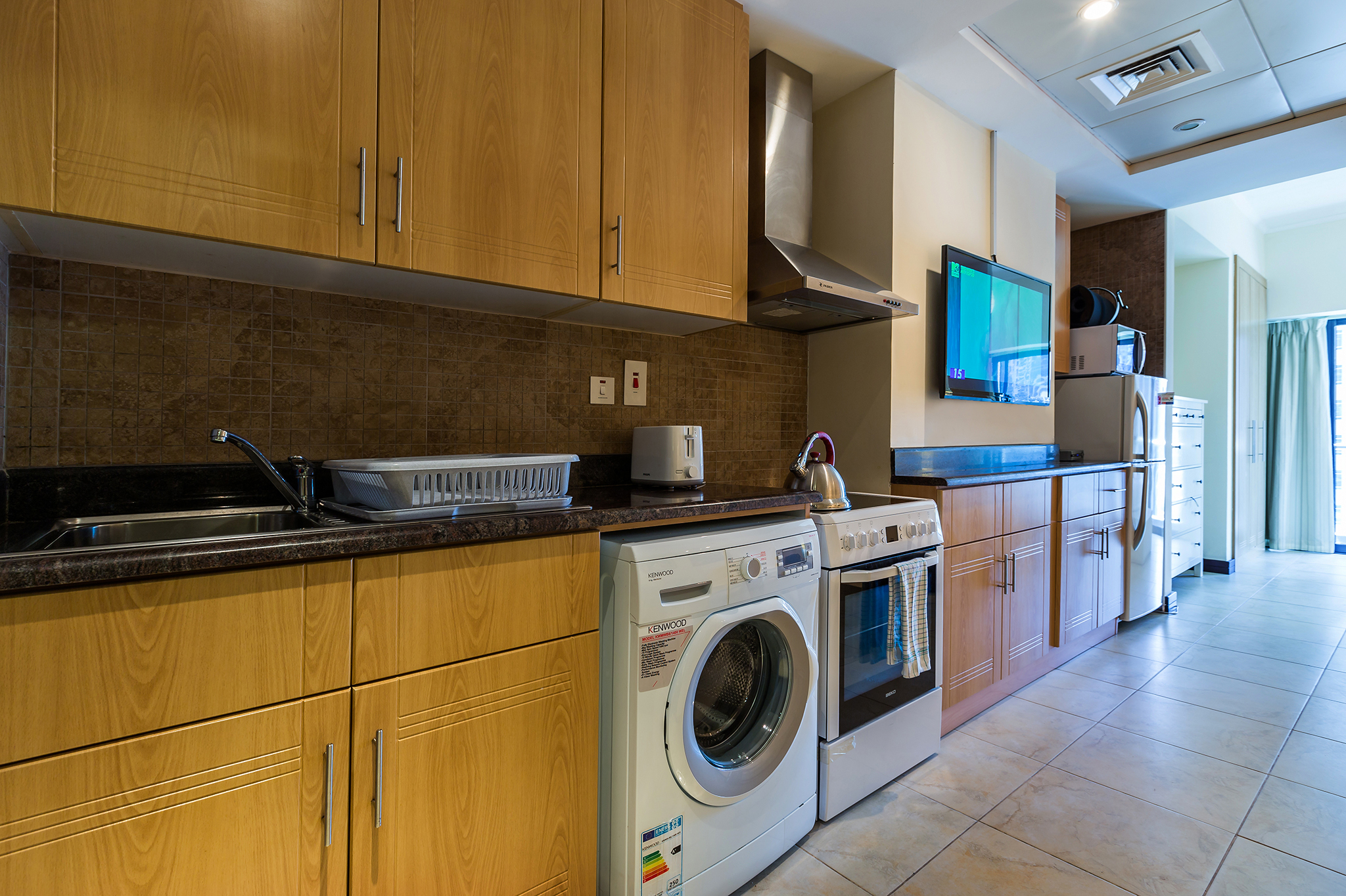 The kitchenette with all you need to feel at home including microwave, kettle, toast and fridge-freezer