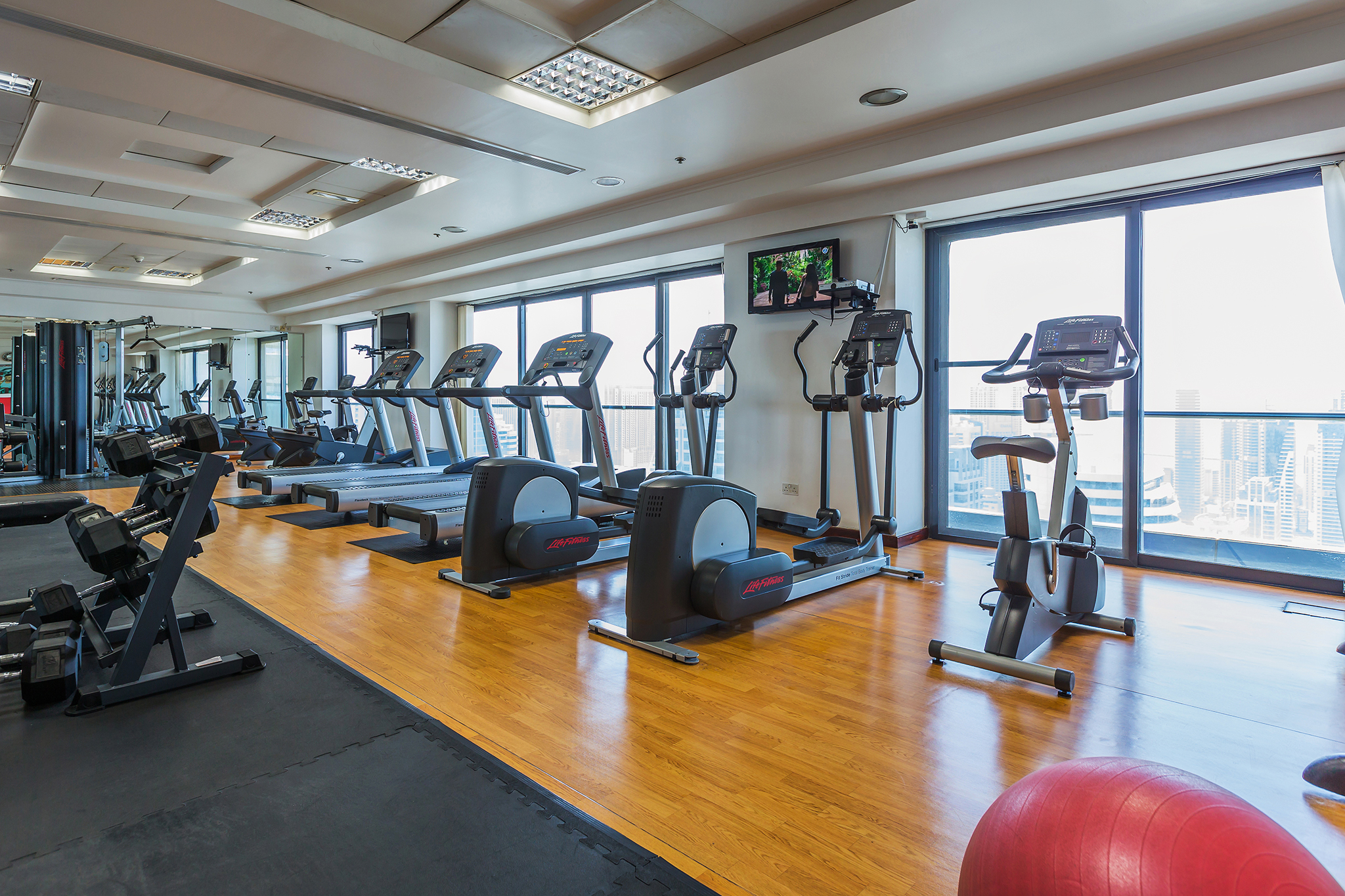 Air conditioned and fully equipped gym with a beautiful city view.