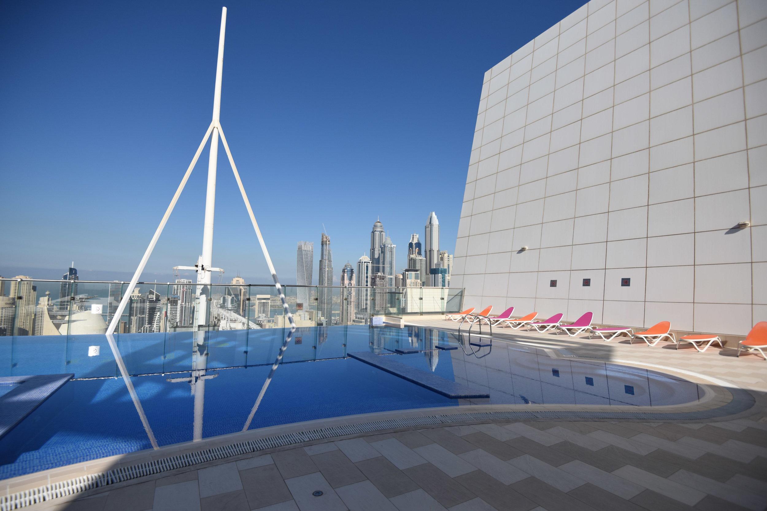 Roof top pool with views of Dubai Marina and the spectacular Dubai skyline
