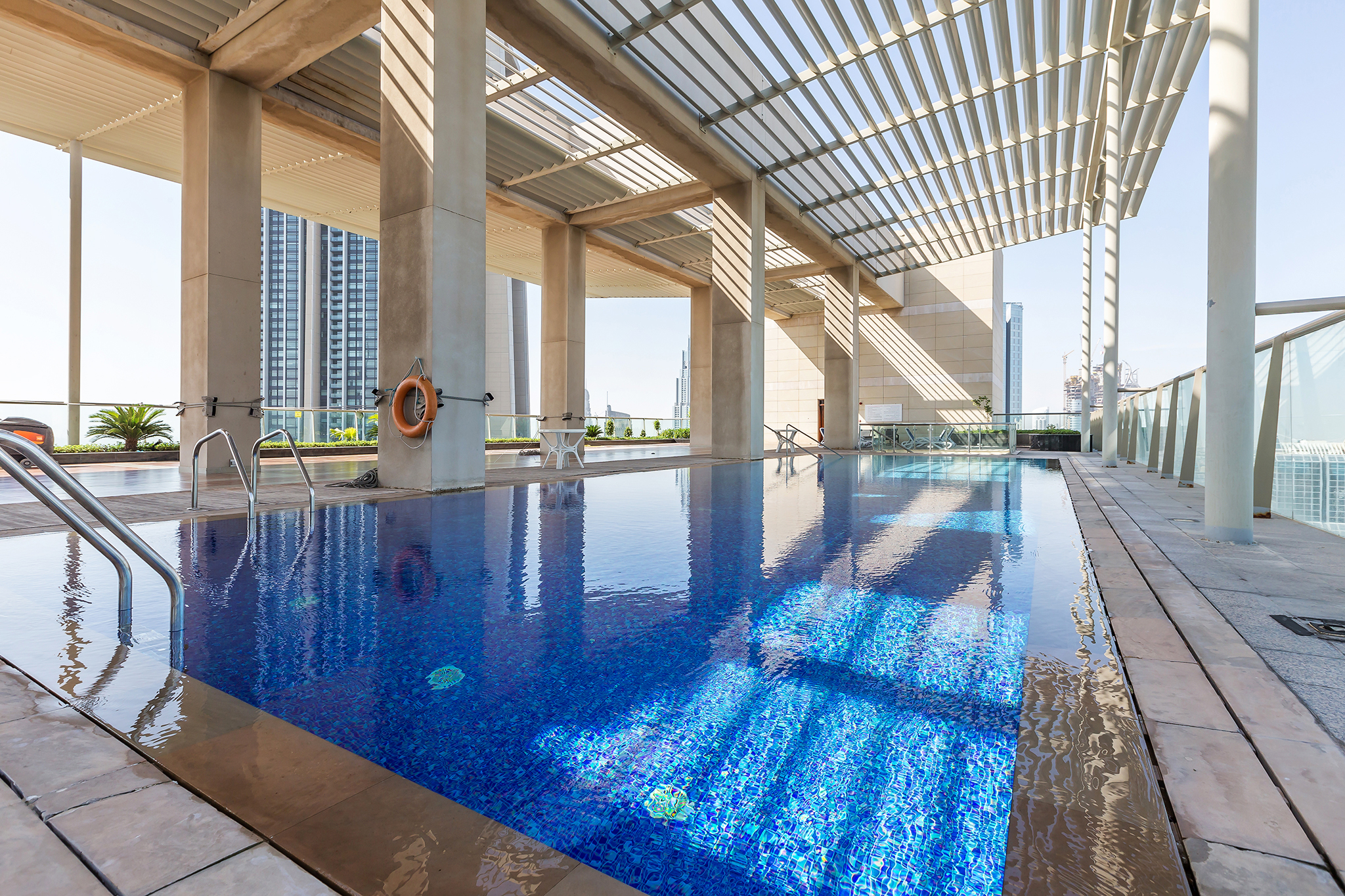 There are not one but TWO outdoor, temperature controlled pools in the building, with spectacular views