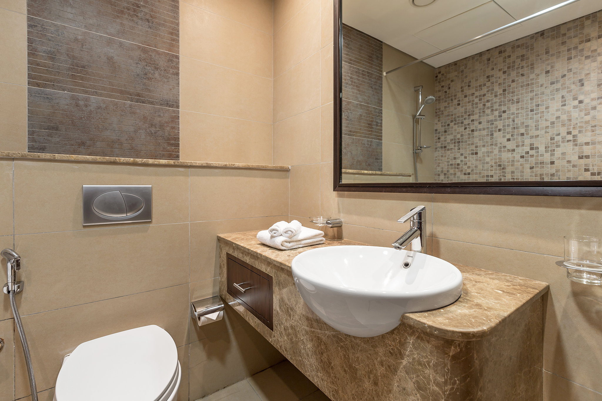 The spacious bathroom has everything you need including a large wall mirror and a hair dryer
