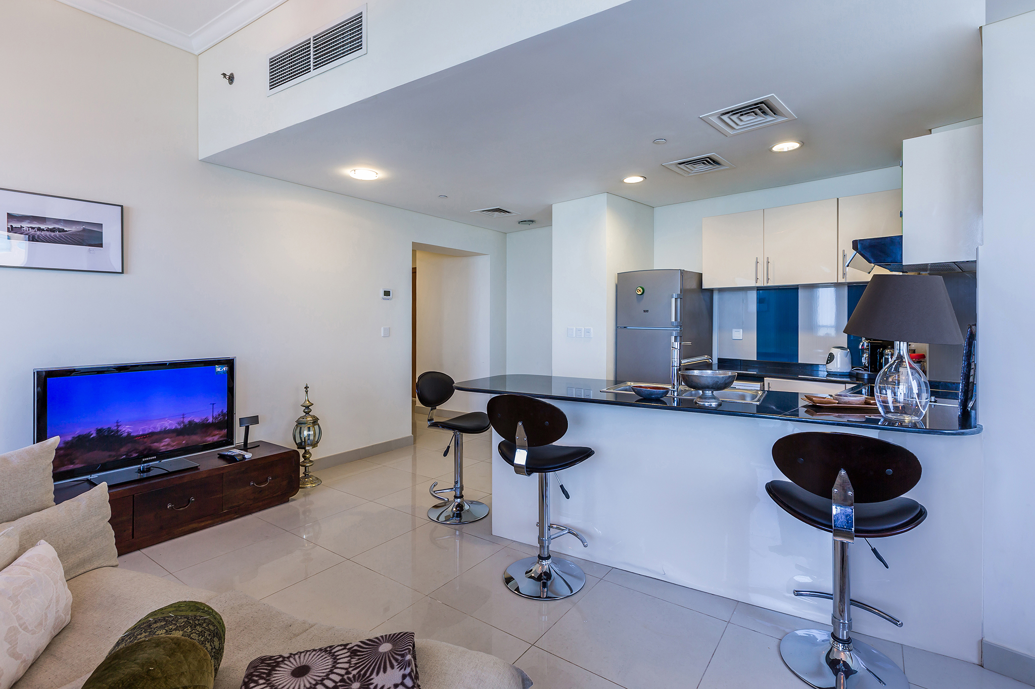 The kitchen and living area is complete with stylish & contemporary furnishings