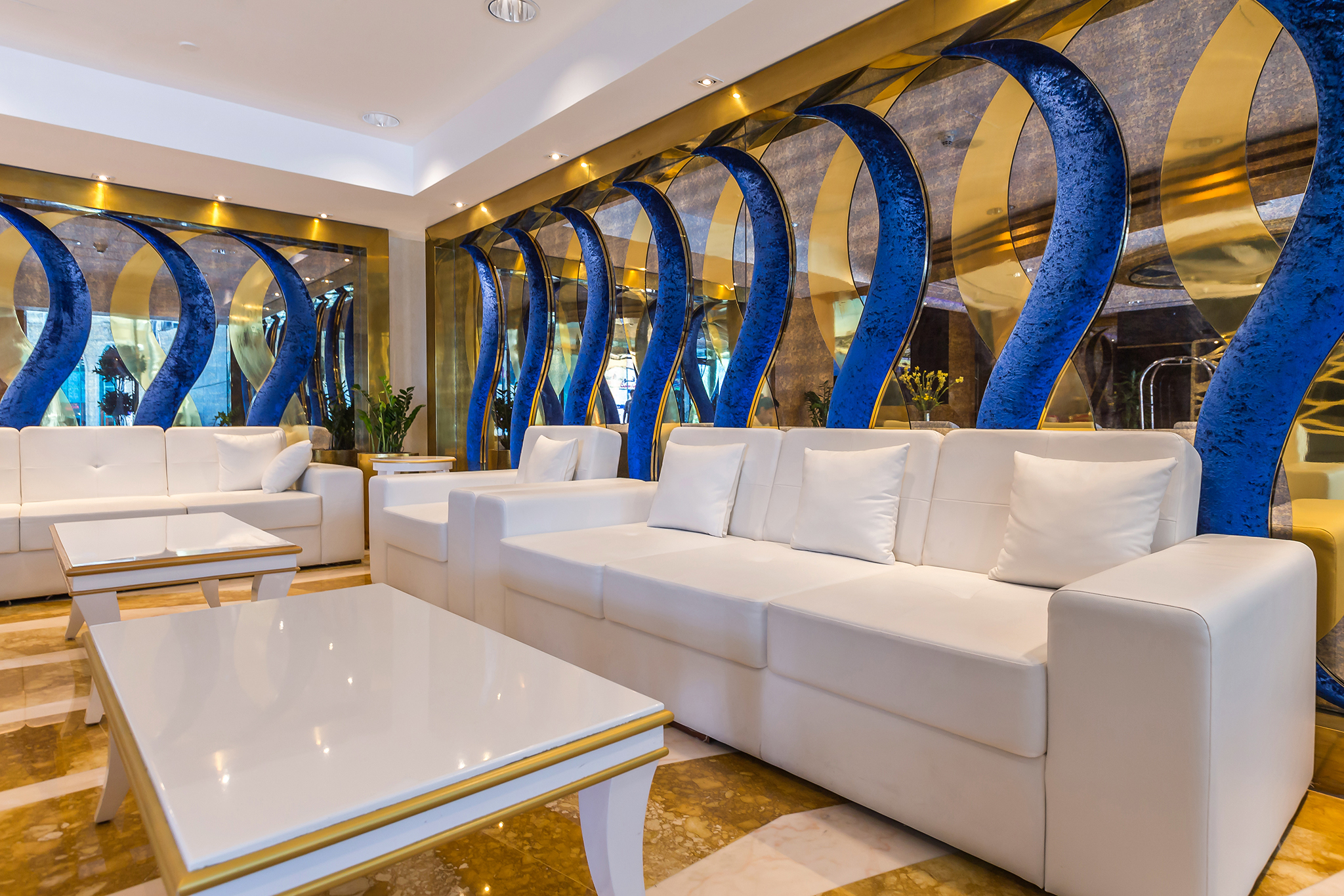 Stunning gold and white themed building lobby