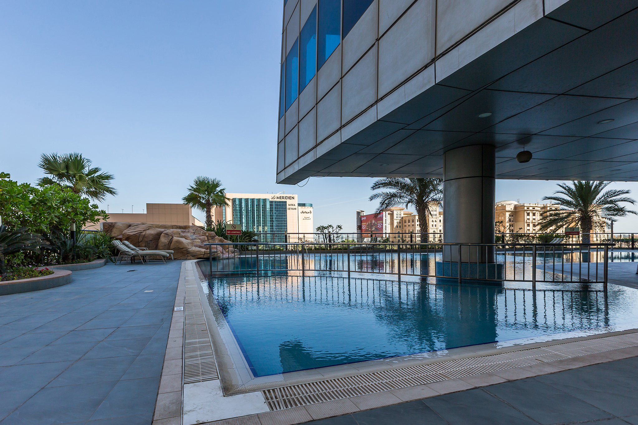 The temperature controlled pool is the perfect setting for watching the sunset beautifully over Dubai Marina