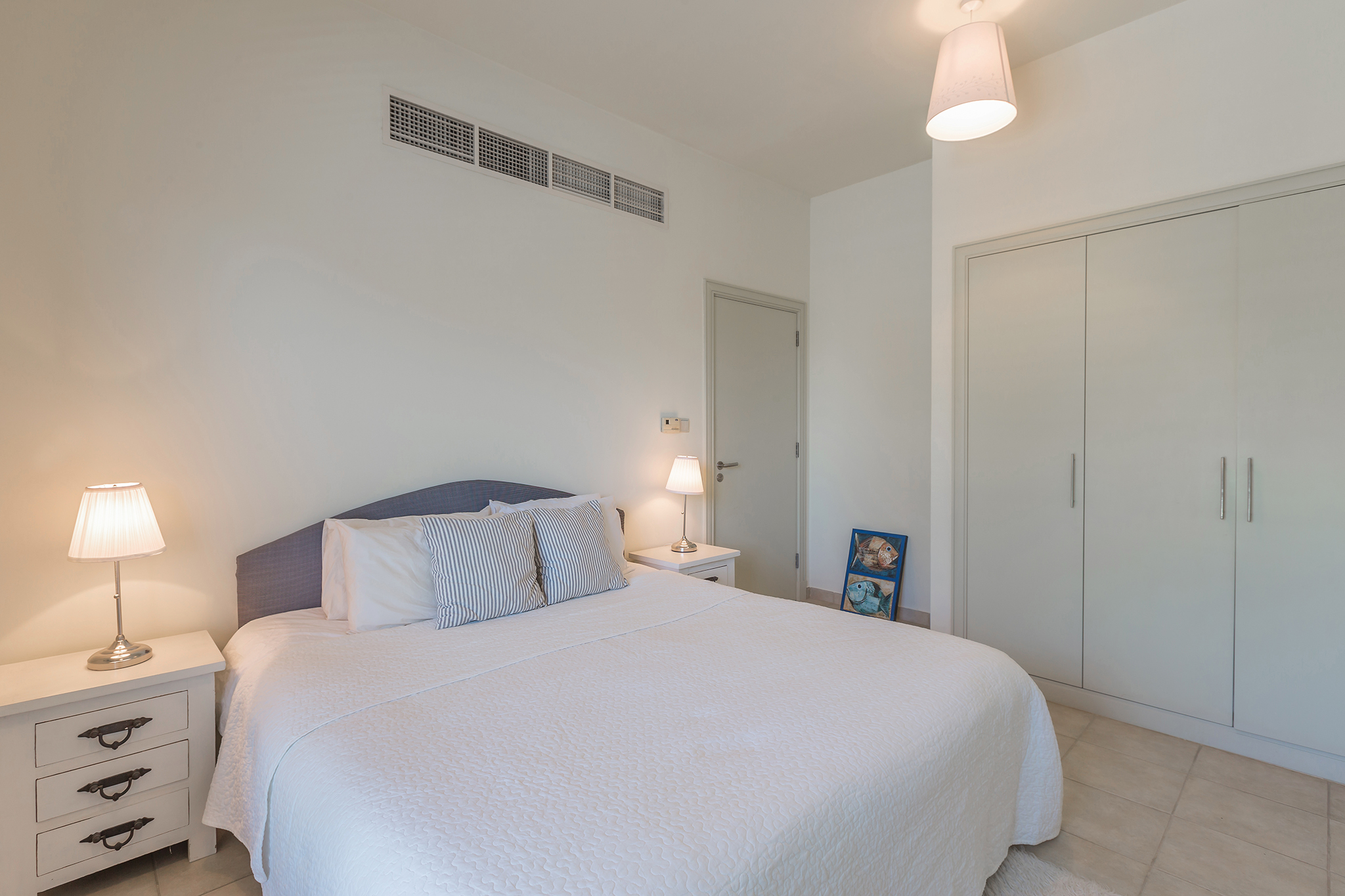 Guest's bedroom with comfortable king-sized bed