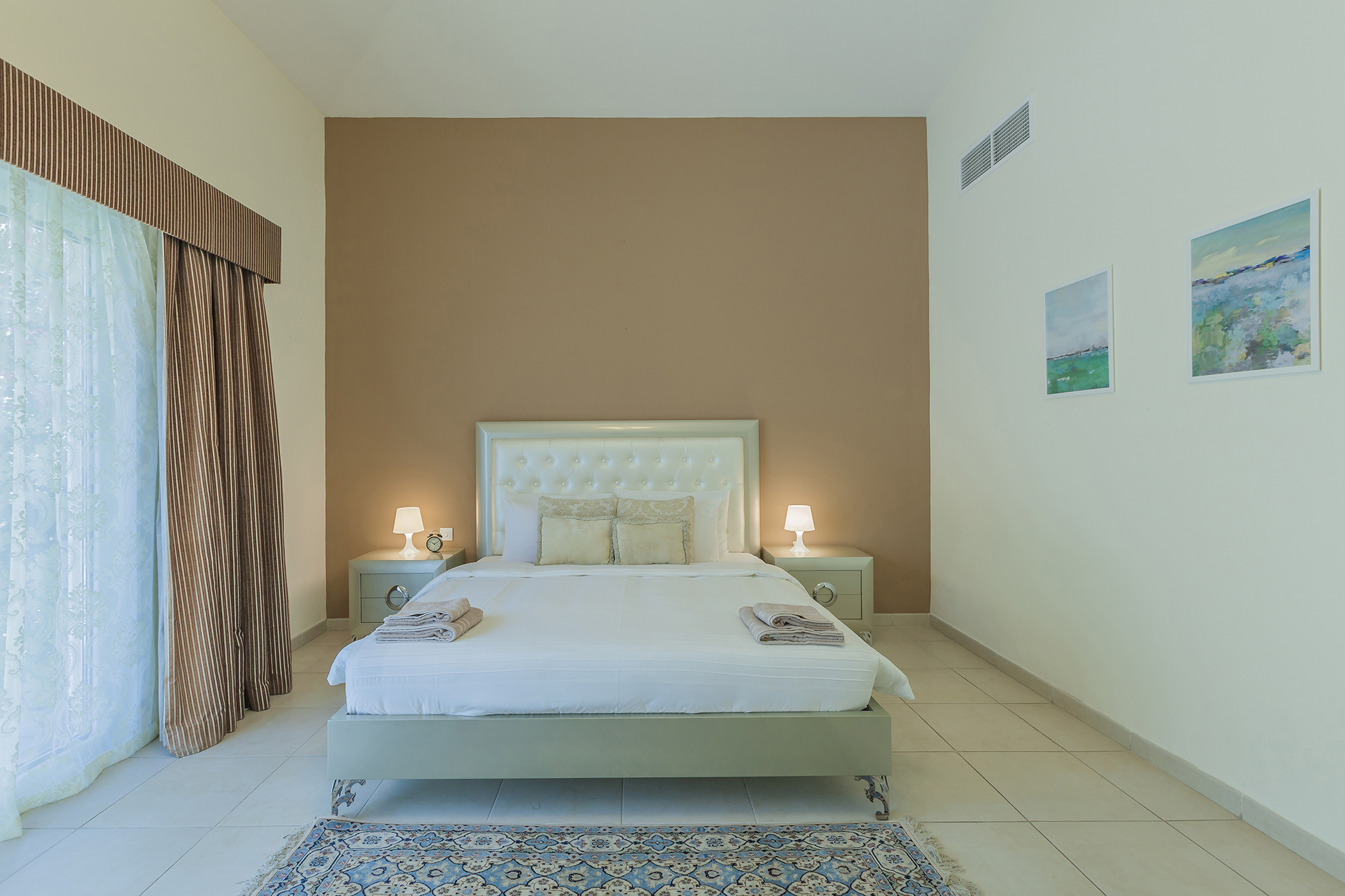 Spacious master bedroom with access to the garden