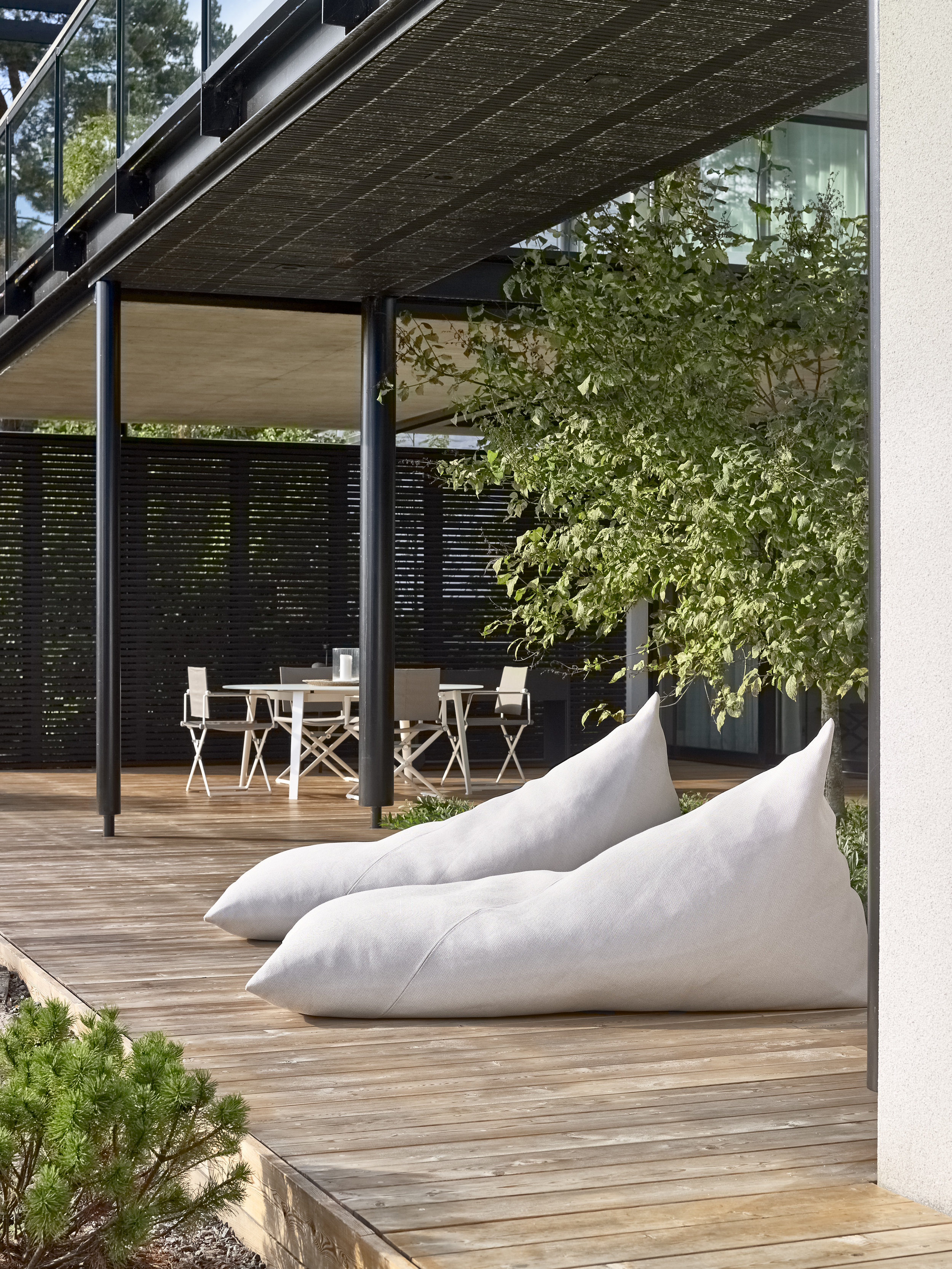 4612  Roo lounge  chairs upholstered with Saimaa outdoor fabric.