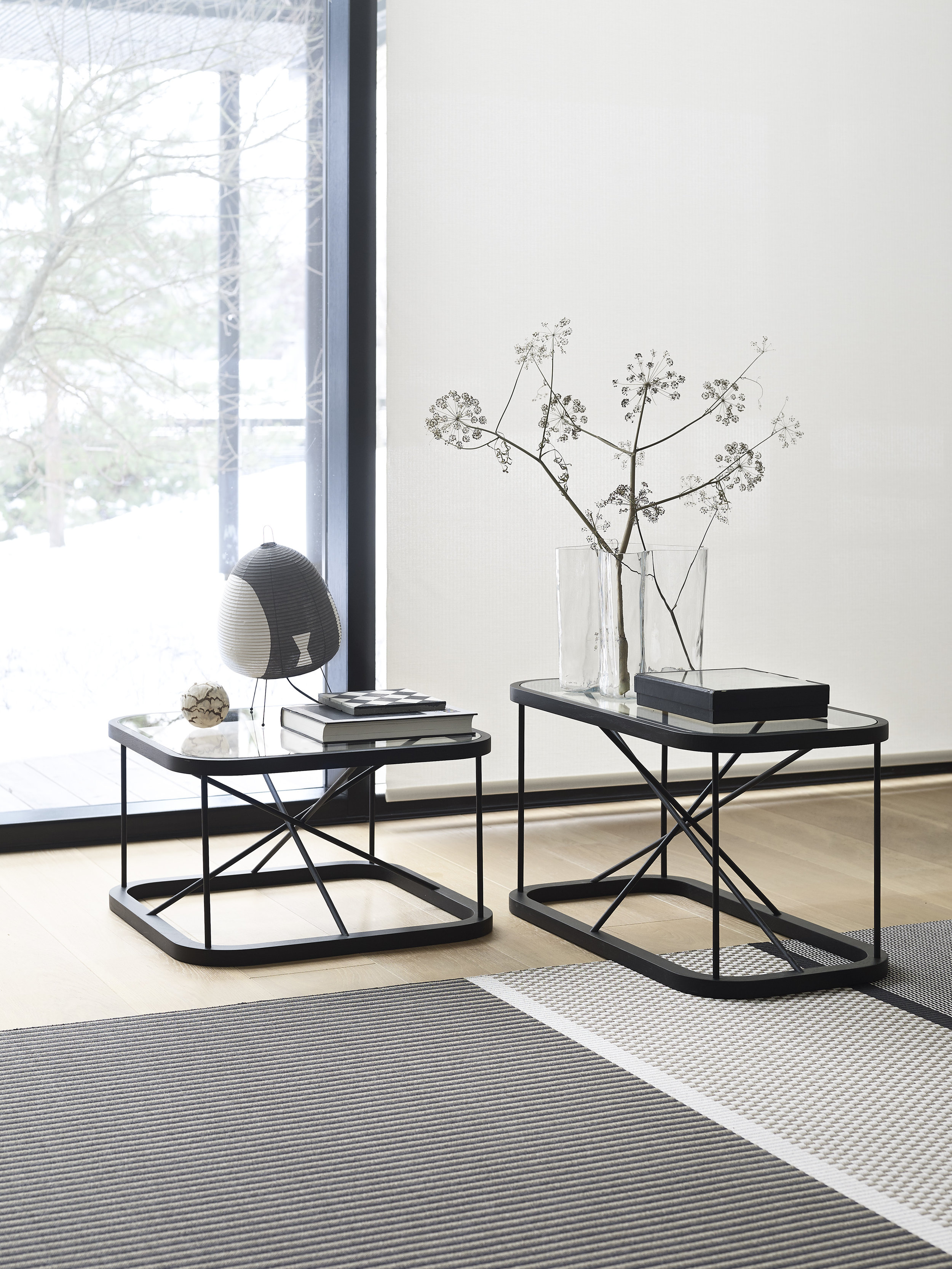 Stained black  Twiggy oak tables , size 66,5x66,5x38,5 cm and 44x88x45,5 cm, together with  San Francisco  paper yarn carpet col. 1433215 nutria-stone.