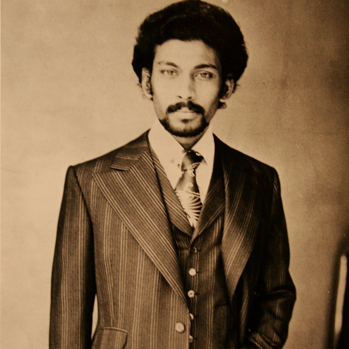 Andrew Ramroop in 1975 wearing the suit he made for the Federation of Master Tailors Contest