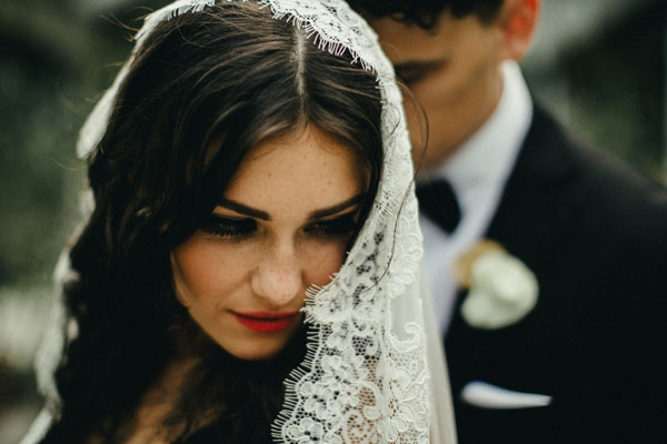 bride-wearing-spanish-veil-mantilla-alencon-lace.jpg