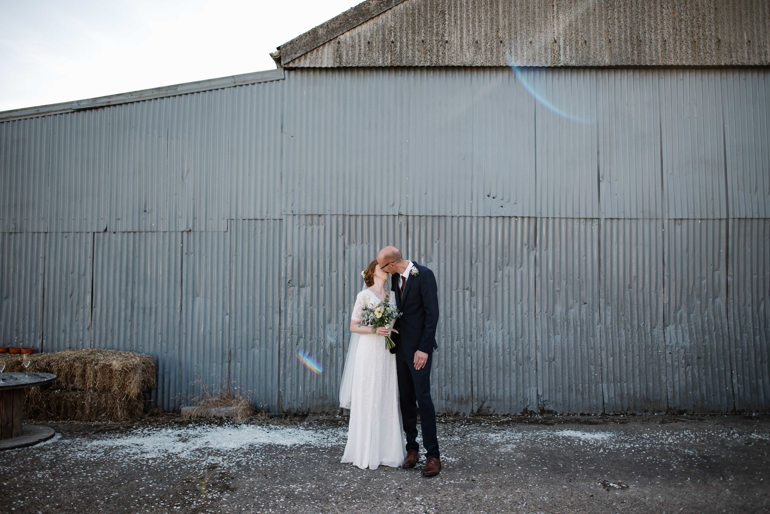 ginny + dave - blue sky outdoor ceremony, space hopper racing and limbo contests at sunset