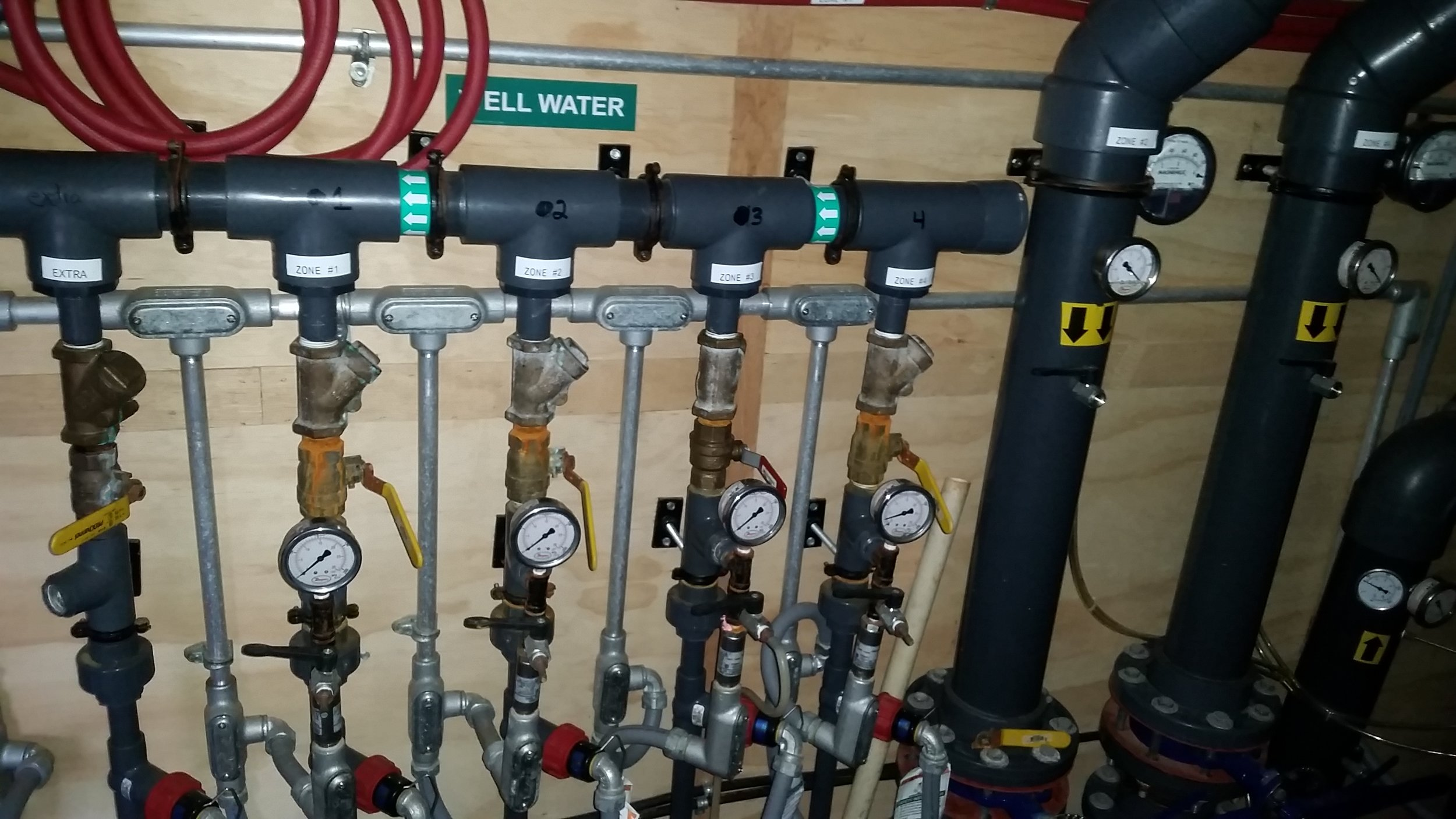 Valves and piping in place as part of the multi-phase extraction system used for remediation at the site.