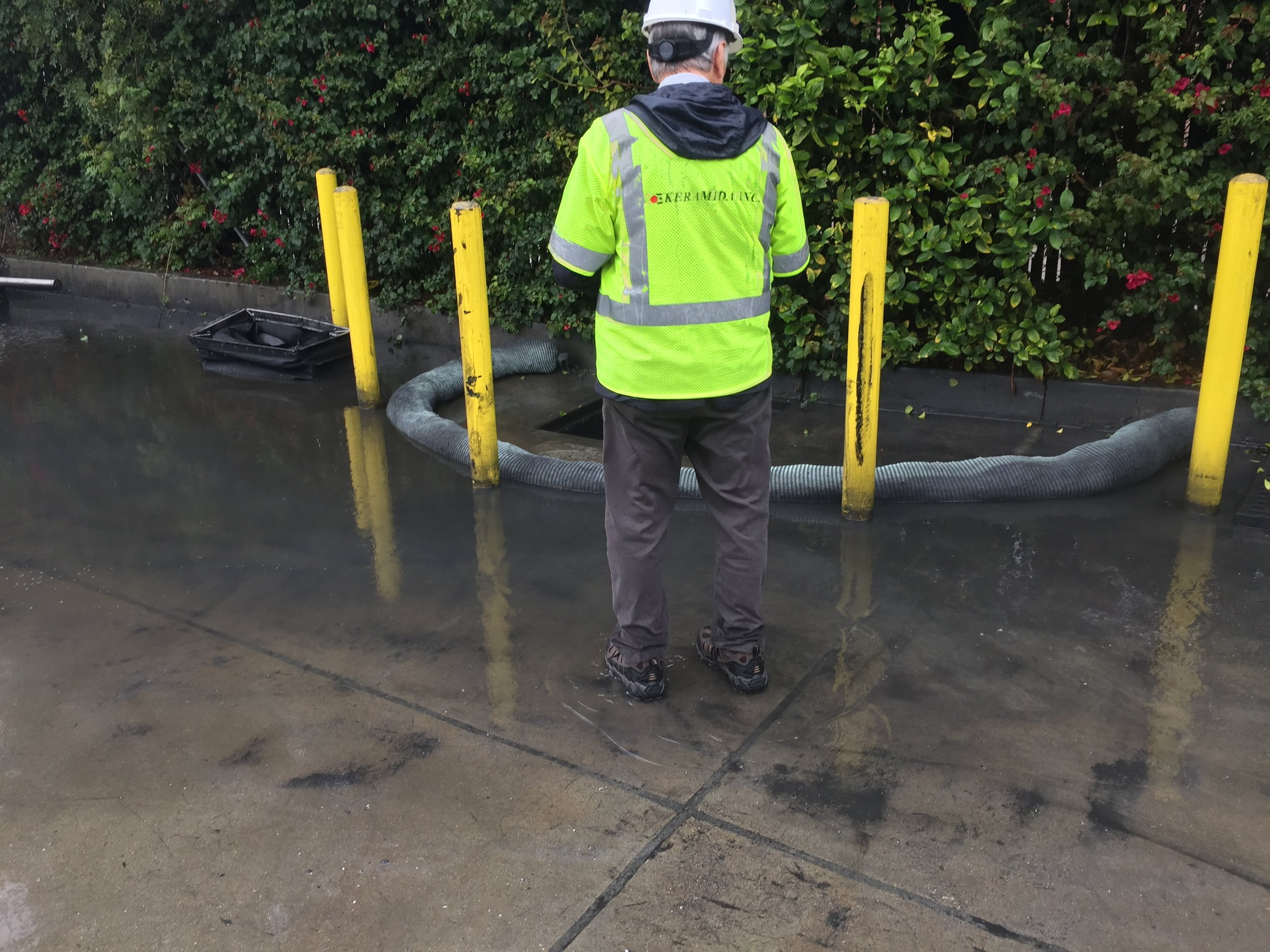 Vice President, Ron Hayes, observes the stormwater discharge process at one of the facility's sampling points.