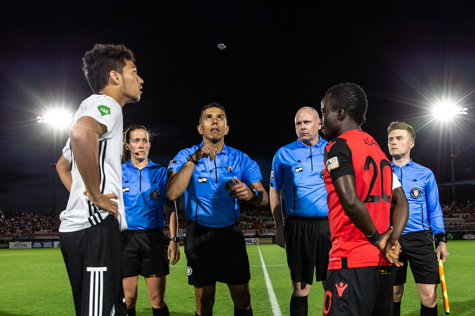 Melissa (far left) and crew conduct the coin toss at a Phoenix Rising FC match.