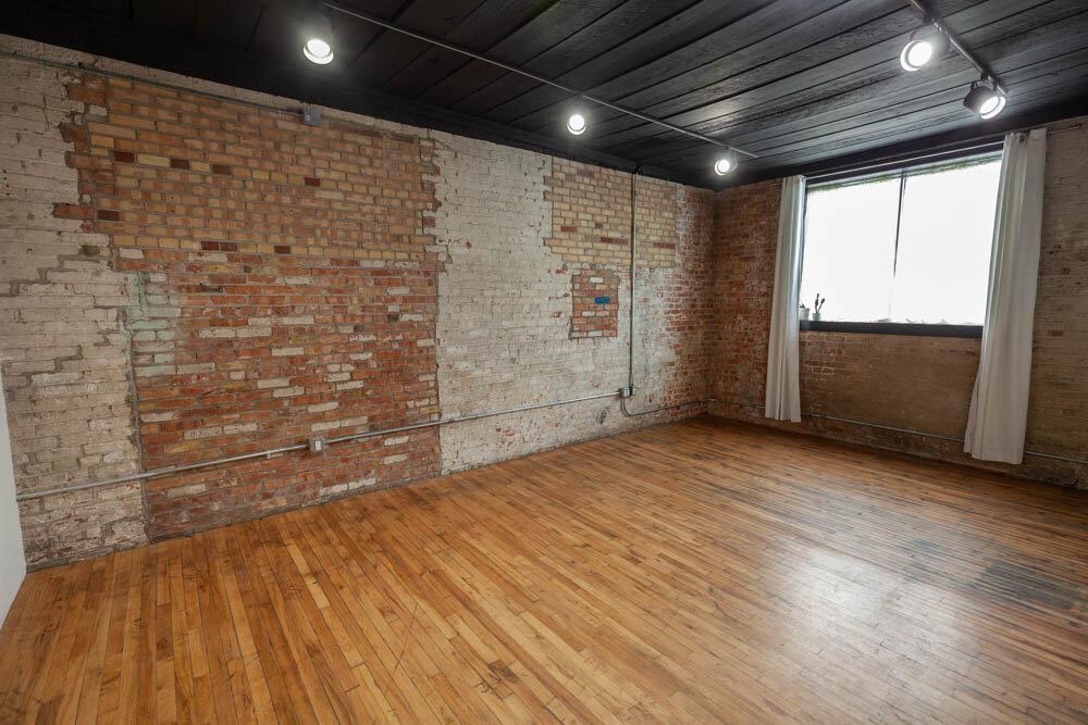 Studio B - Brick Wall