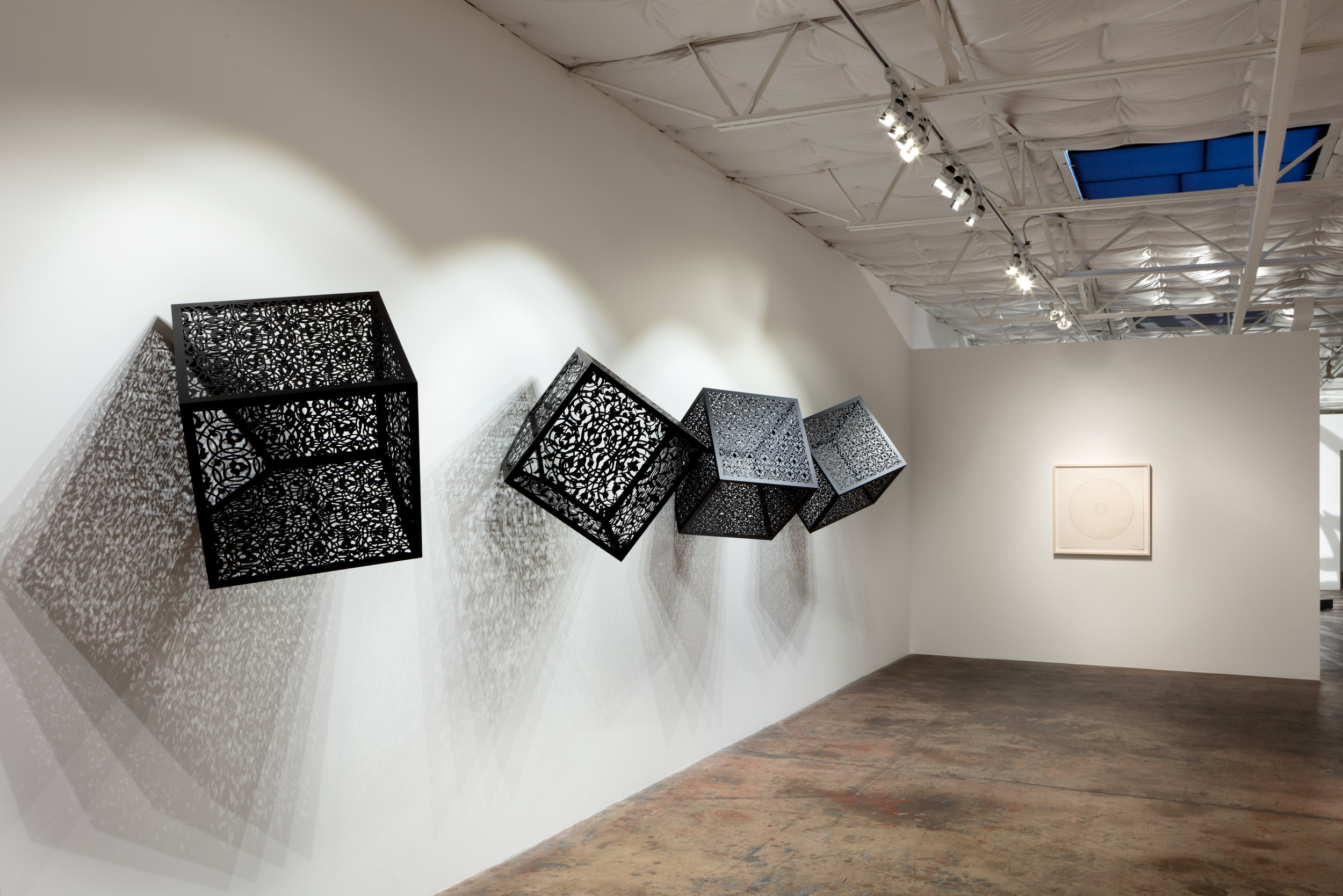 Itinerant Shadows: Bola, Spiral, Caged Flowers, Arches  Installation at Talley Dunn Gallery, Dallas, TX, 2019    Laser-cut Black Lacquered Steel  2' for each cube  Itinerant Shadows Artist Statement