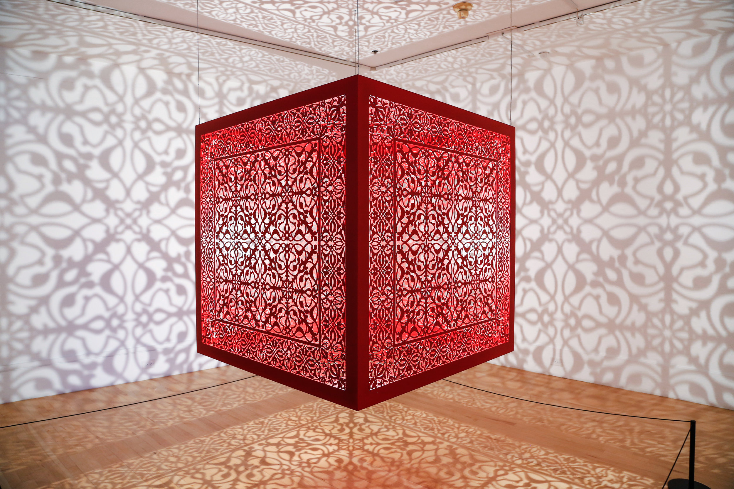 "Shimmering Mirage - Red   Lacquered steel and halogen bulb  48"" x 48"" x 48"" 2019"